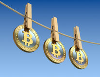 Bitcoins  with wooden clothespin Royalty Free Stock Photos