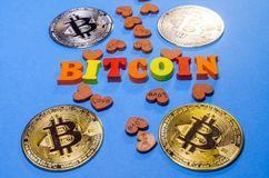 Bitcoins with wooden letters stock image