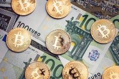 Bitcoins y euros imágenes de archivo libres de regalías