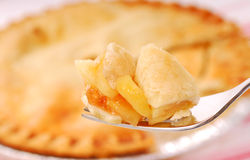 Bite of apple pie on a fork Royalty Free Stock Photography