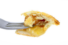 Bite of apple pie on fork Stock Photography