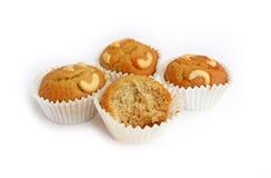 Bite Banana cupcake with cashew nut Stock Images
