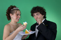 Bite of Cake. A couple with their wedding cake stock image