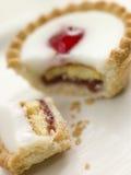 Bite of a Cherry Bakewell Tart Stock Image