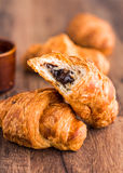Bite croissant with chocolate, french baking Stock Photos