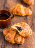 Bite croissant with chocolate, french baking Royalty Free Stock Image