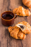 Bite croissant with chocolate, french baking Stock Image