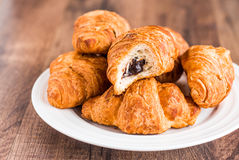 Bite croissants with chocolate on a white plate, breakfast Stock Photography