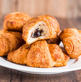 Bite croissants with chocolate on a white plate Royalty Free Stock Photography