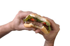 Bite of a hamburger Stock Photos