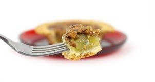 Bite of pecan pie on fork Royalty Free Stock Image