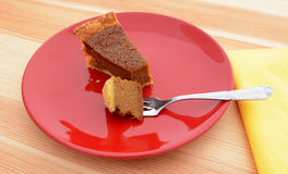 Bite of pumpkin pie on a fork Stock Photography