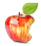 Bite on a red Apple. Red apple eaten with a bite,  on white background Royalty Free Stock Photo