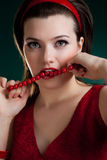 Bite the red  beads Royalty Free Stock Image