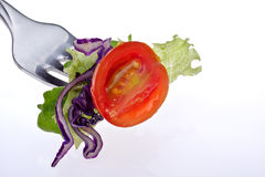 A bite of salad. Isolated on a white background Stock Photo