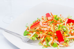 A bite of salad. Isolated on a white background Royalty Free Stock Images