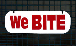 We Bite Sign. Caution sign in the zoo warning  from animals that bite Stock Photos