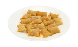 Bite size pepperoni pizza rolls on white plate Royalty Free Stock Photography
