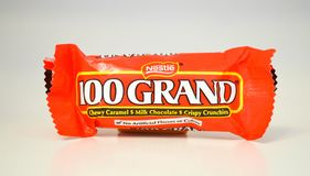 Bite size servings of a chocolate 100 Grand candy bar. Bite size servings of red package of a chocolate and crunchy 100 Grand candy bar on a white background Stock Photography