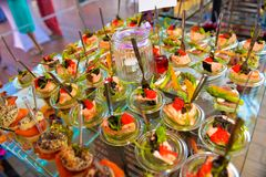 Sea Food, Bite-Sized, Colorful Amuse-Bouches, Kitchen Ingredients. Colorful and beautiful bite-sized hors d`oeuvre. Amuse-bouches with tomatoes, salmon, caviar Stock Images