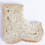Bite slice of bread Stock Photo
