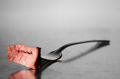 Bite of steak. A bite of steak on a fork Stock Photo
