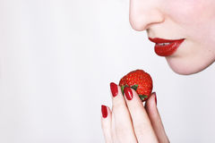 Bite a strawberry Royalty Free Stock Images