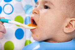 Bite of very hungry baby child Royalty Free Stock Photos