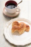 Bited croissant and coffee cup Stock Photography