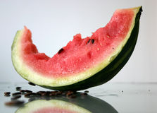 Bited off watermelon. Slice of bited watermelon, close-up stock photography