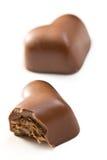 biten chokladhjärta arkivbild