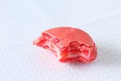 Biten fransk macaron på vit bakgrund royaltyfri foto