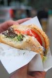 biten hamburgare royaltyfri fotografi