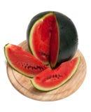 biten skivade vattenmelonen för brädet cuttingen fotografering för bildbyråer
