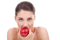 She bites red apple Stock Photography