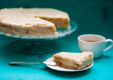 Bithday cake. Slice of cake with tea on the table Stock Photo