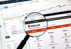 Bithumb cryptocurrency exchange. MONTREAL, CANADA - DECEMBER 23, 2017 : Bithumb cryptocurrency exchange website under magnifying glass Stock Images