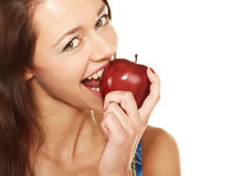 Biting the apple. Face of young woman biting the red apple stock photos