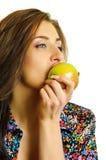 Biting apple Royalty Free Stock Photo
