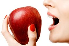Biting apple Stock Photo