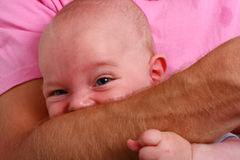 Biting baby Royalty Free Stock Images