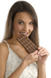 Biting chocolate Royalty Free Stock Image