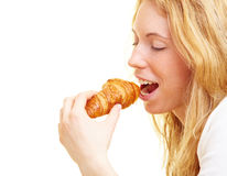 Biting in a croissant Royalty Free Stock Photography