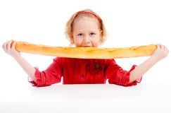 Biting French bread Royalty Free Stock Images