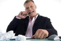 biting frustrated man pen teeth στοκ φωτογραφίες