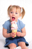 Biting the Ice Cream. A little girl eating ice cream Stock Images