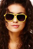 Biting lip. Fashion portrait of biting lip lady in yellow sunglasses stock photos