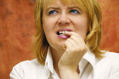Biting nails Stock Image