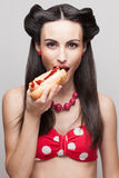 biting off a hot dog pinup smiling model Stock Photos