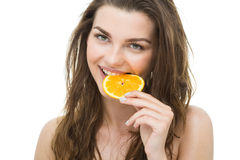 Biting an orange Royalty Free Stock Images